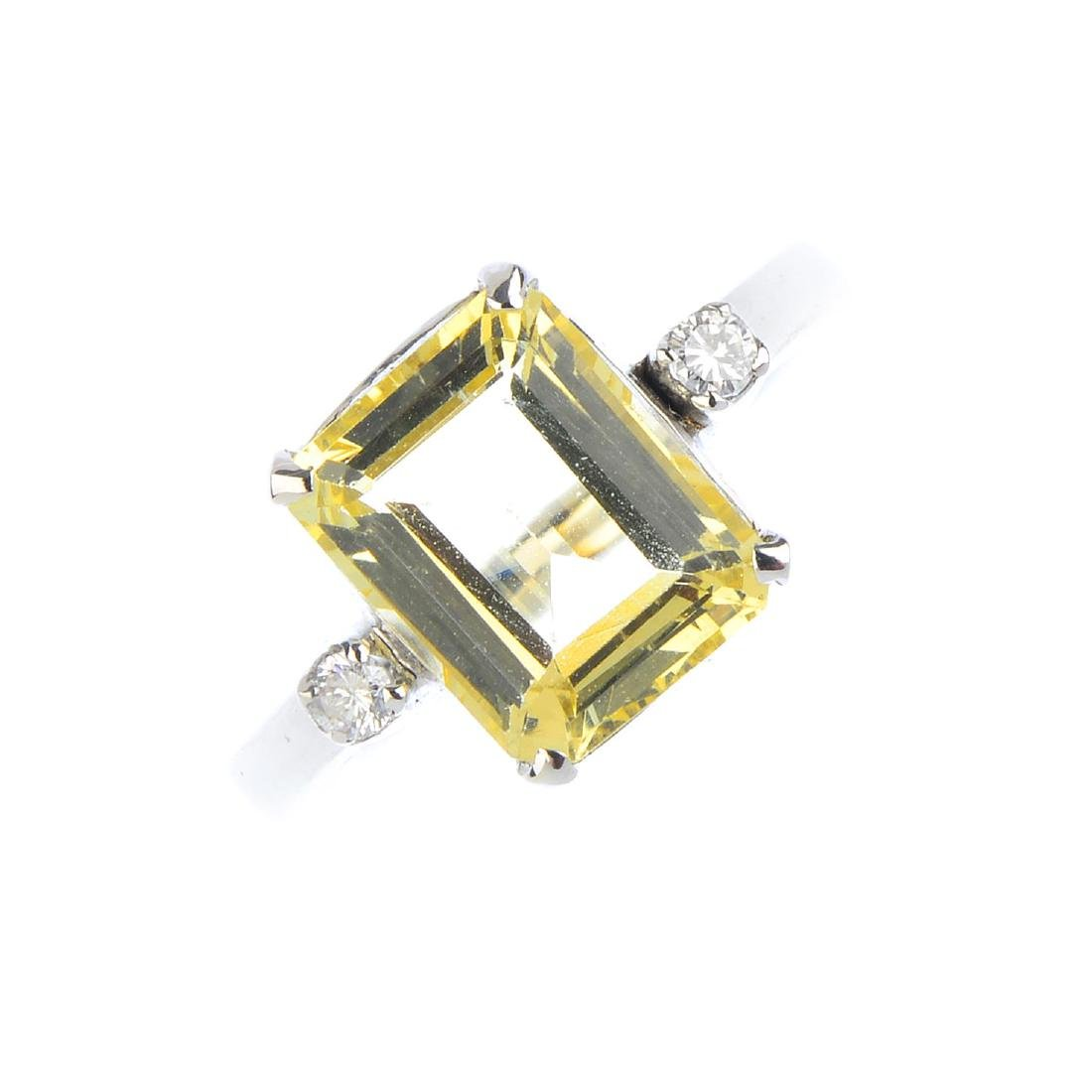 A heliodor and diamond single-stone ring. The