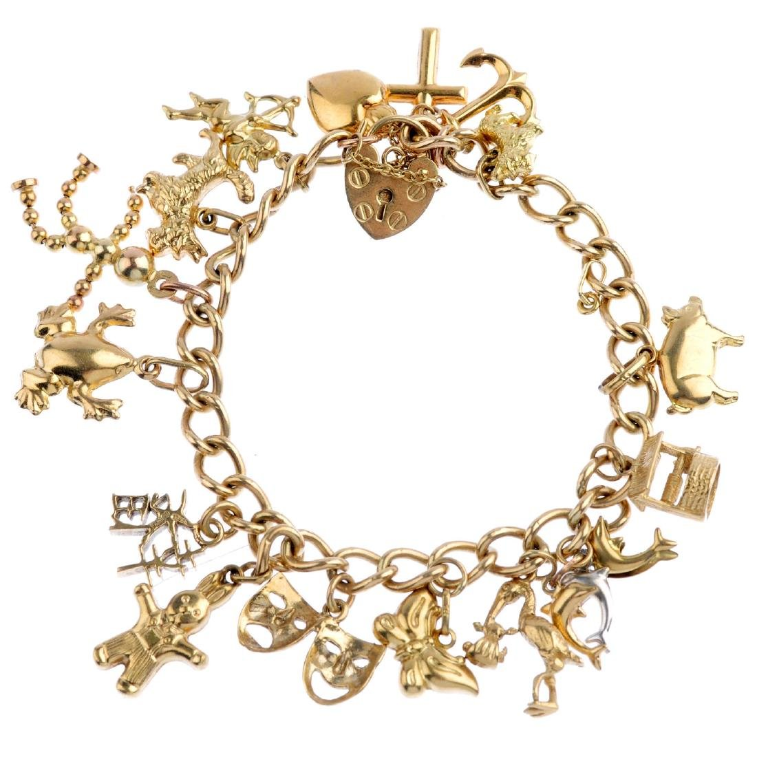 A charm bracelet. The 9ct gold curb-link chain,
