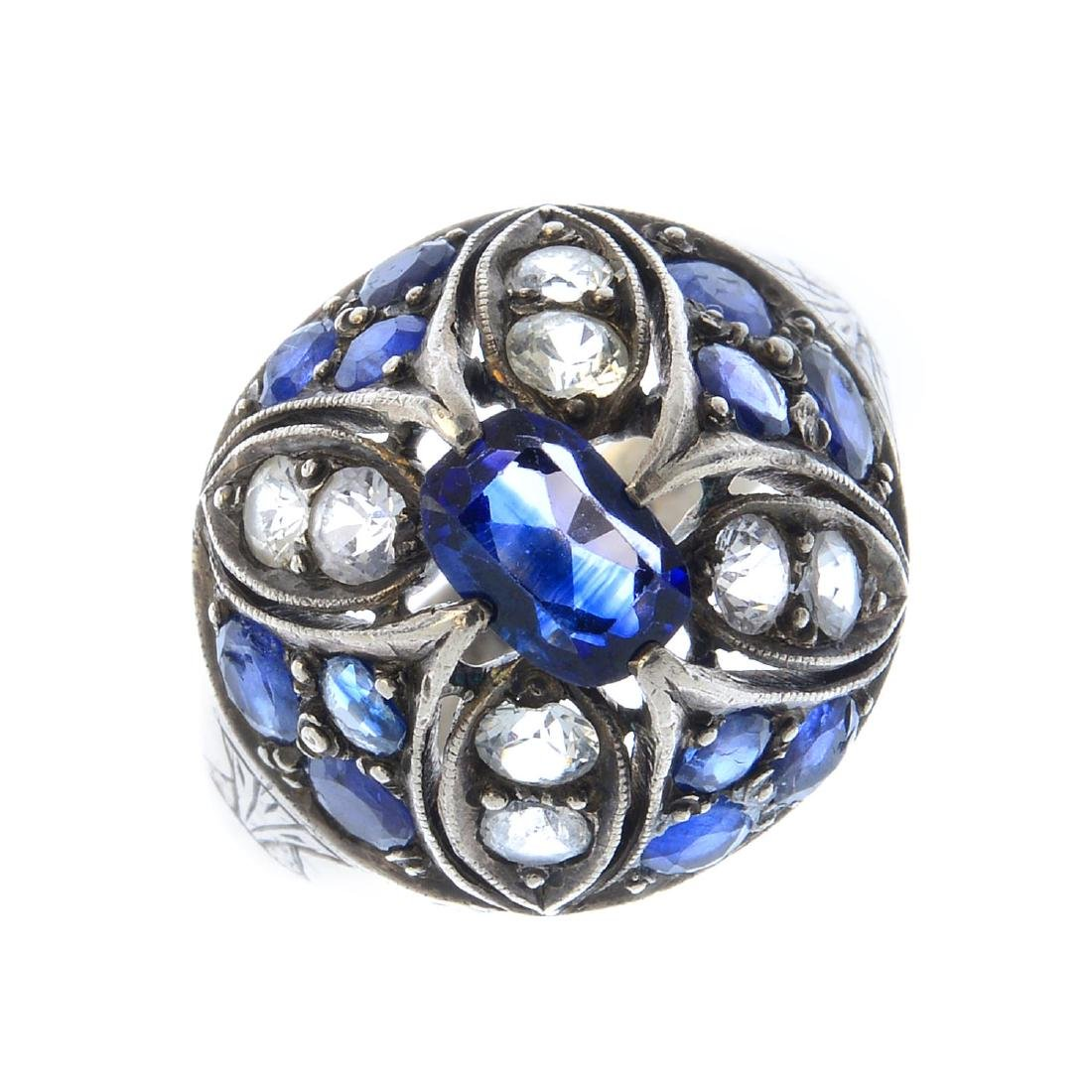 A sapphire dress ring. Of bombe design, the