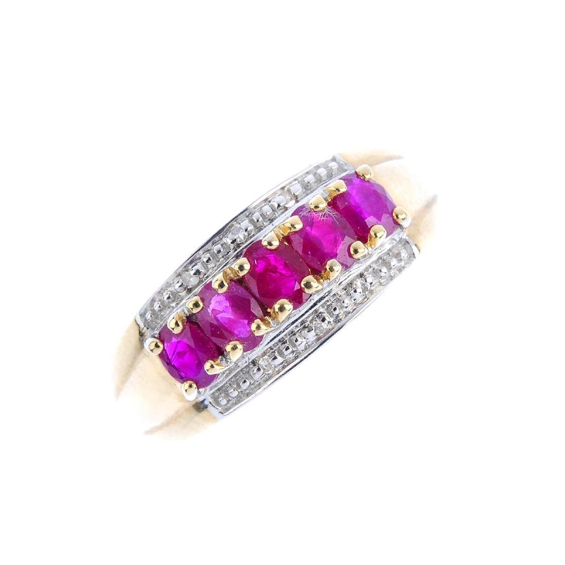 A 9ct gold ruby and diamond ring. The oval-shape ruby