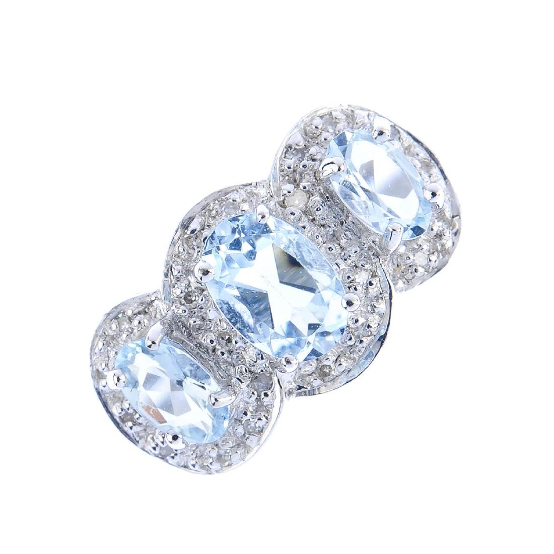 A 9ct gold aquamarine and diamond cluster ring. The