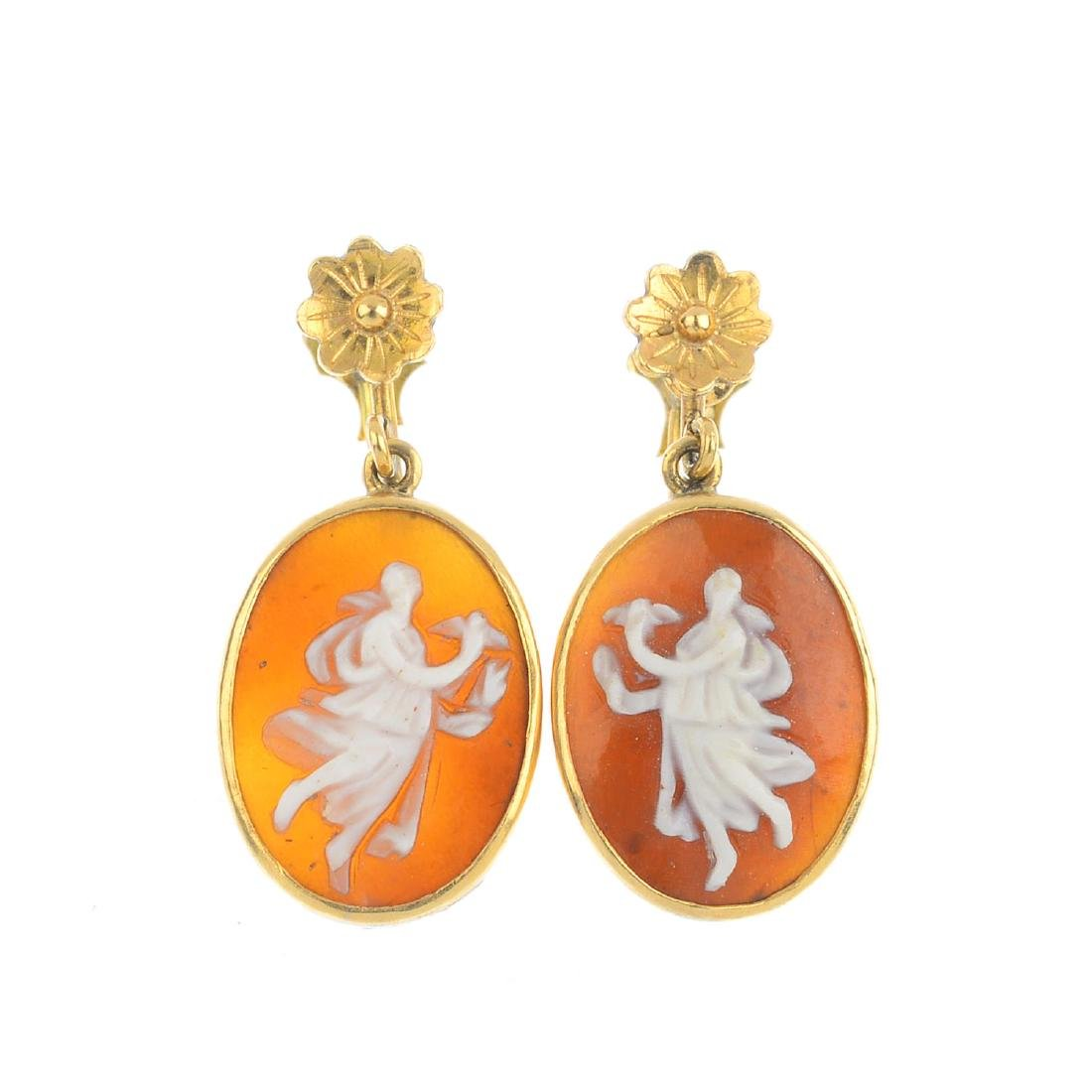 A pair of shell cameo earrings. Each designed as an