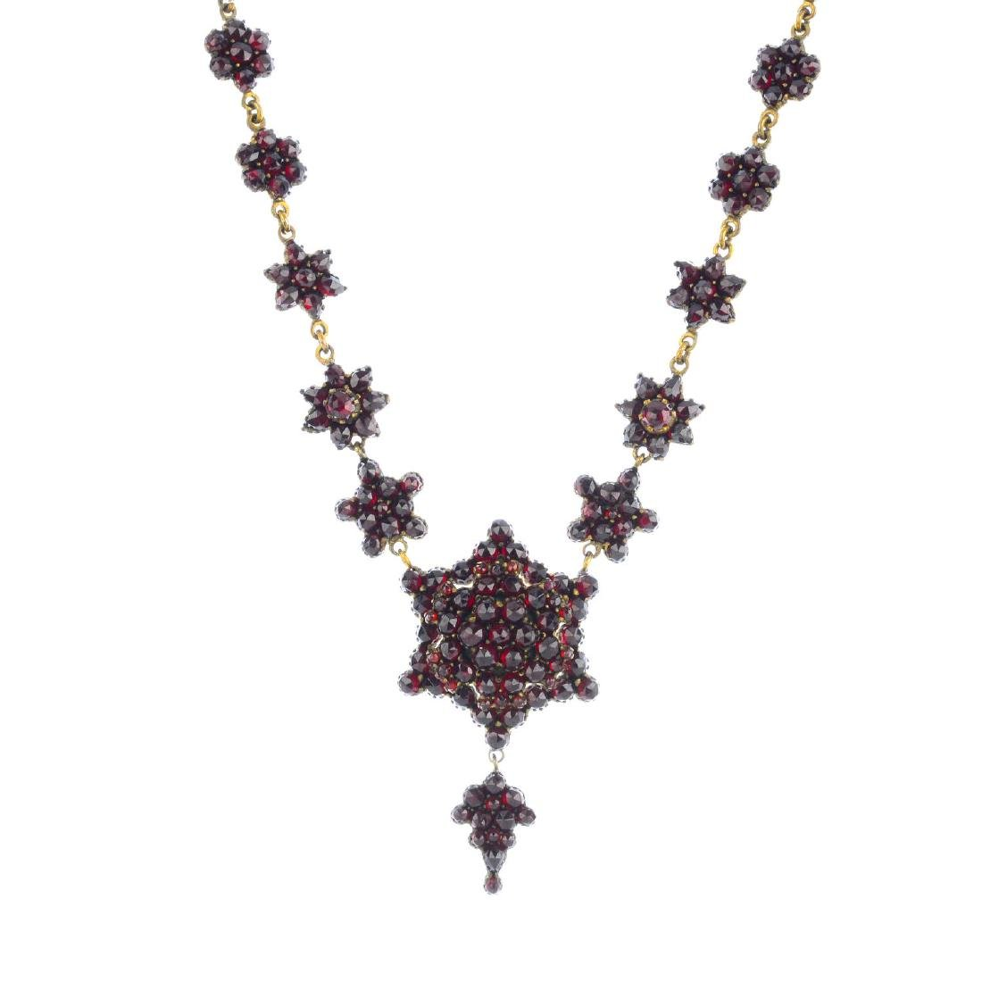 A late Victorian foil-backed garnet necklace. The