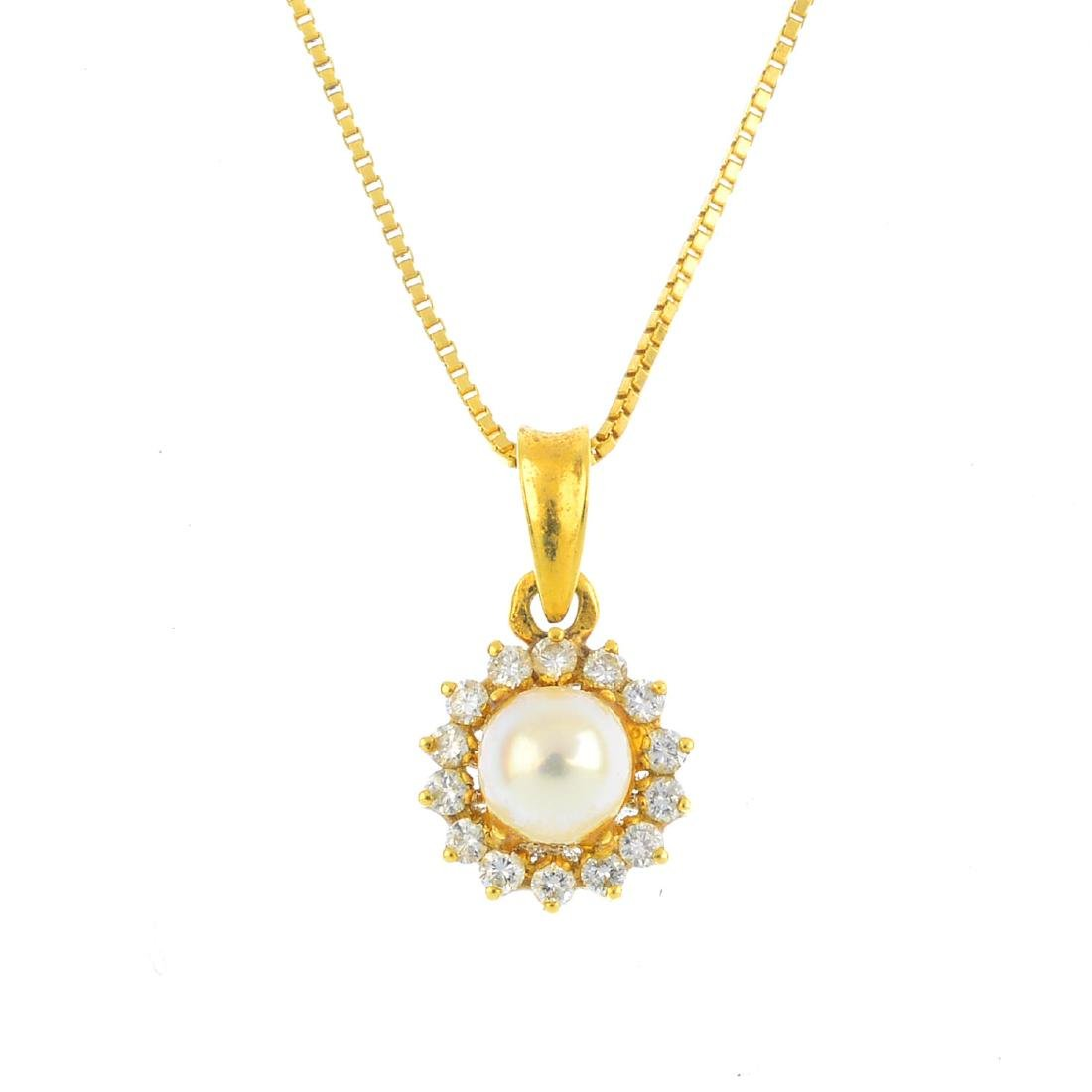 A cultured pearl and diamond pendant. The cultured