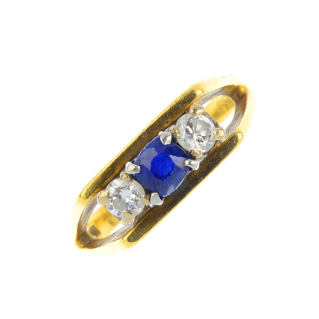 An 18ct gold sapphire and diamond three-stone ring. The