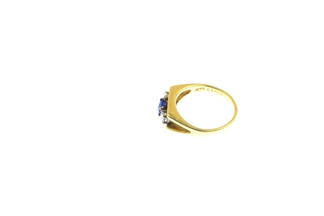 An 18ct gold sapphire and diamond three-stone ring. The - 2