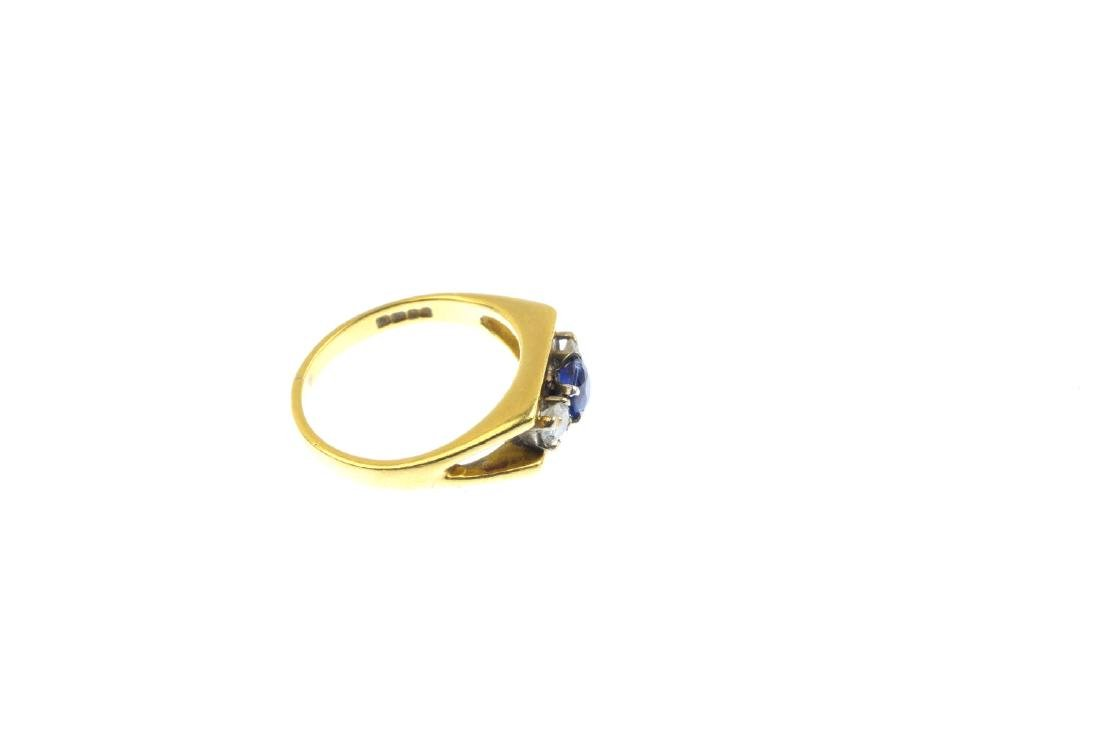 An 18ct gold sapphire and diamond three-stone ring. The - 4