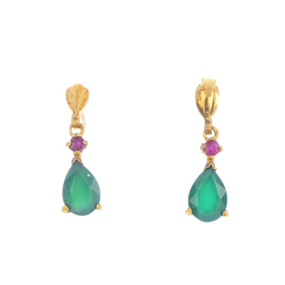 A pair of emerald and ruby earrings. Each designed as a