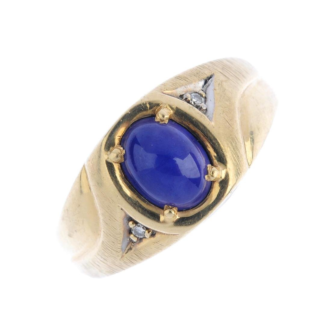 A star sapphire ring. The oval star sapphire cabochon,