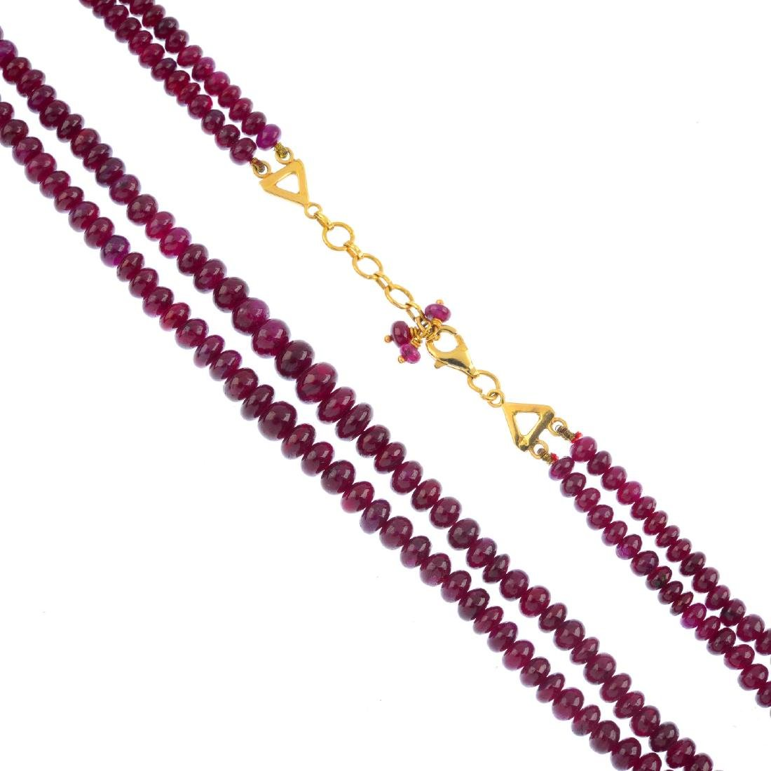 A ruby two-row necklace. Comprising two-row of