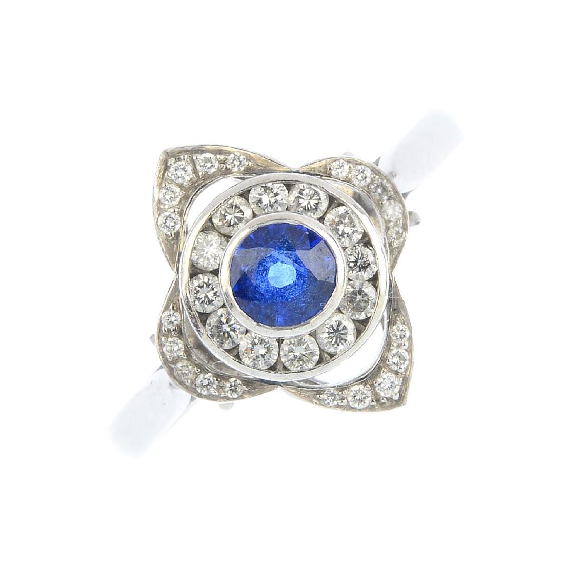 A platinum sapphire and diamond cluster ring. The