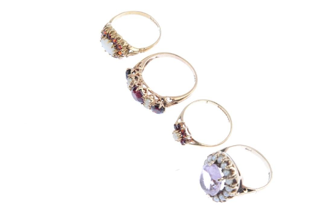 Four gem-set rings. To include a 9ct gold amethyst and - 4