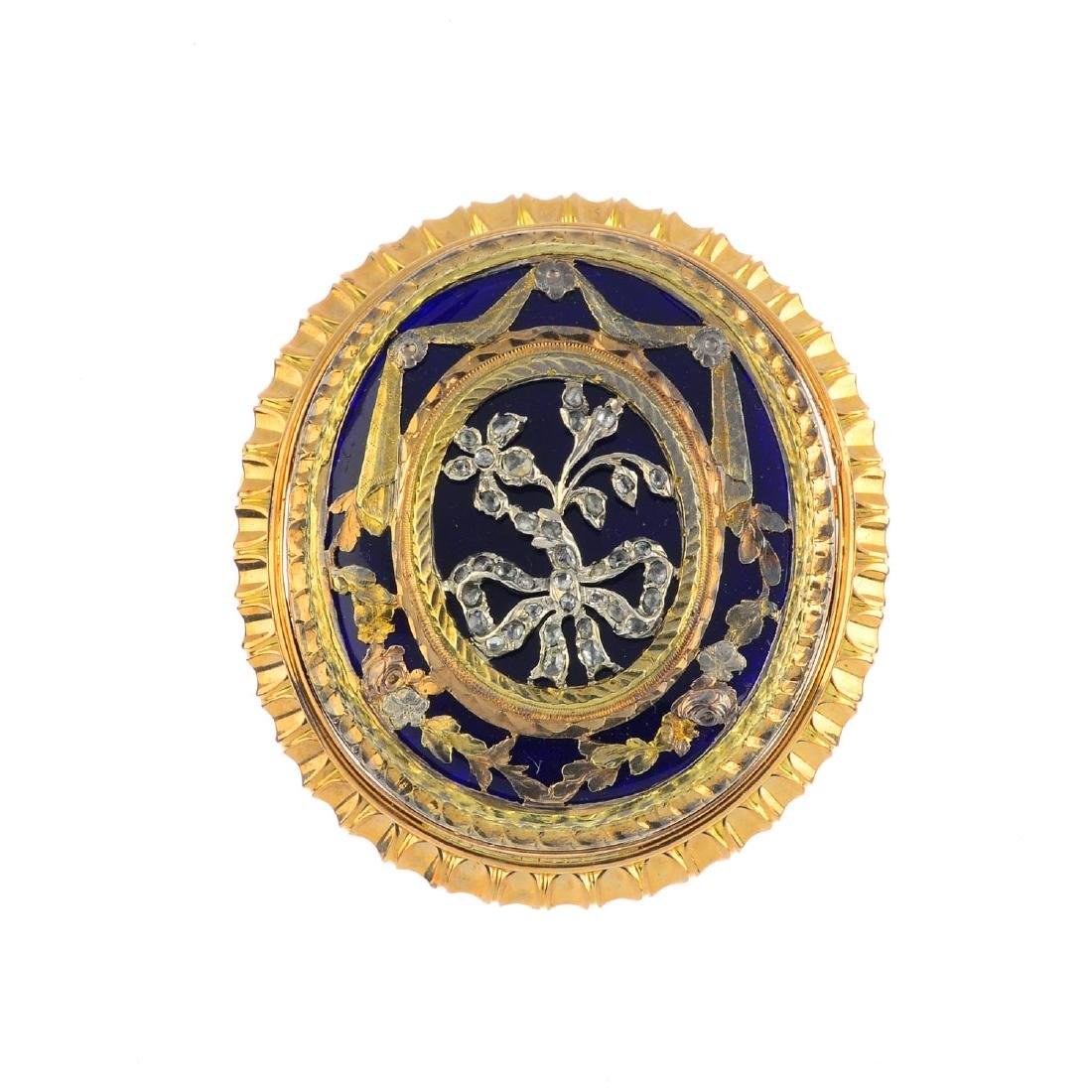 An enamel and diamond brooch. Of oval outline, the