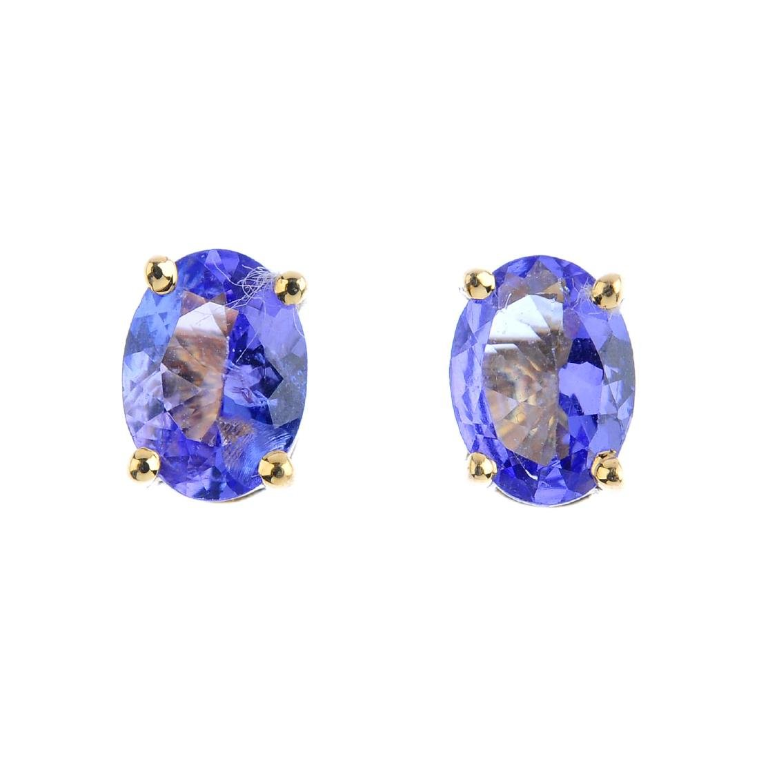 A pair of oval-shape tanzanite stud earrings. Length