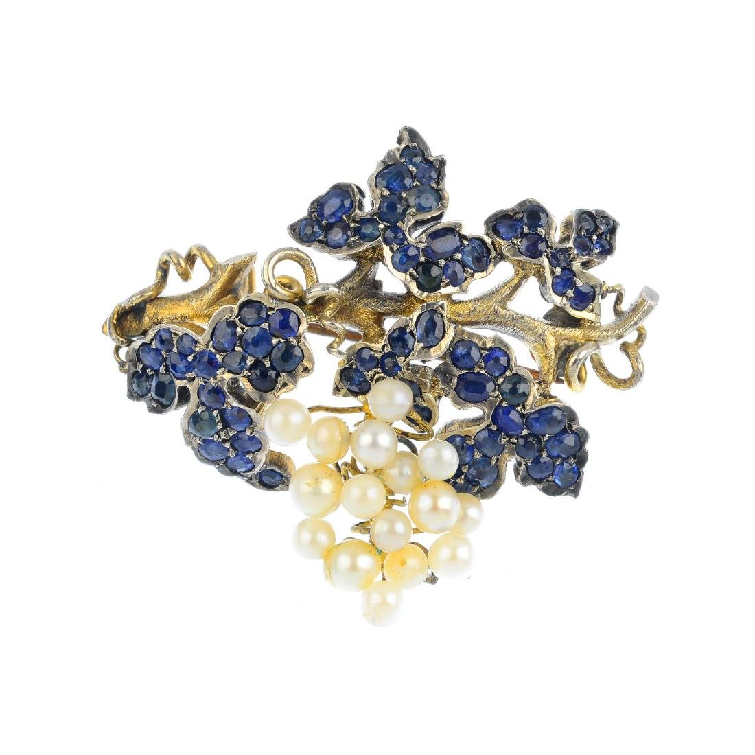 A sapphire and seed pearl brooch. Designed as a bunch