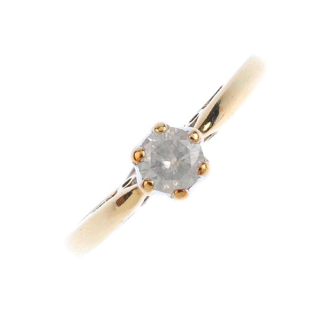 A 9ct gold diamond single-stone ring. The brilliant-cut