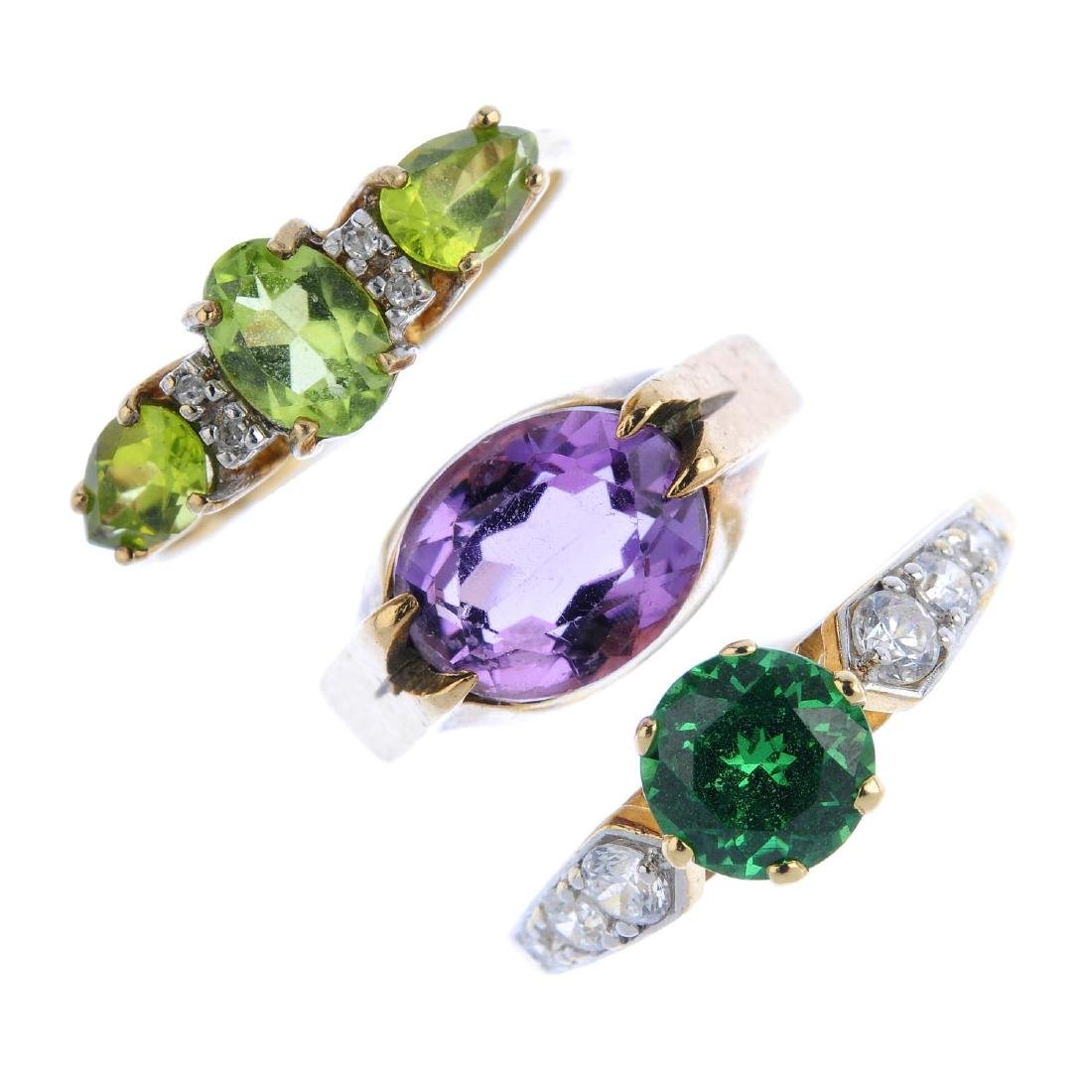 Three gold gem-set rings. To include a 9ct gold peridot