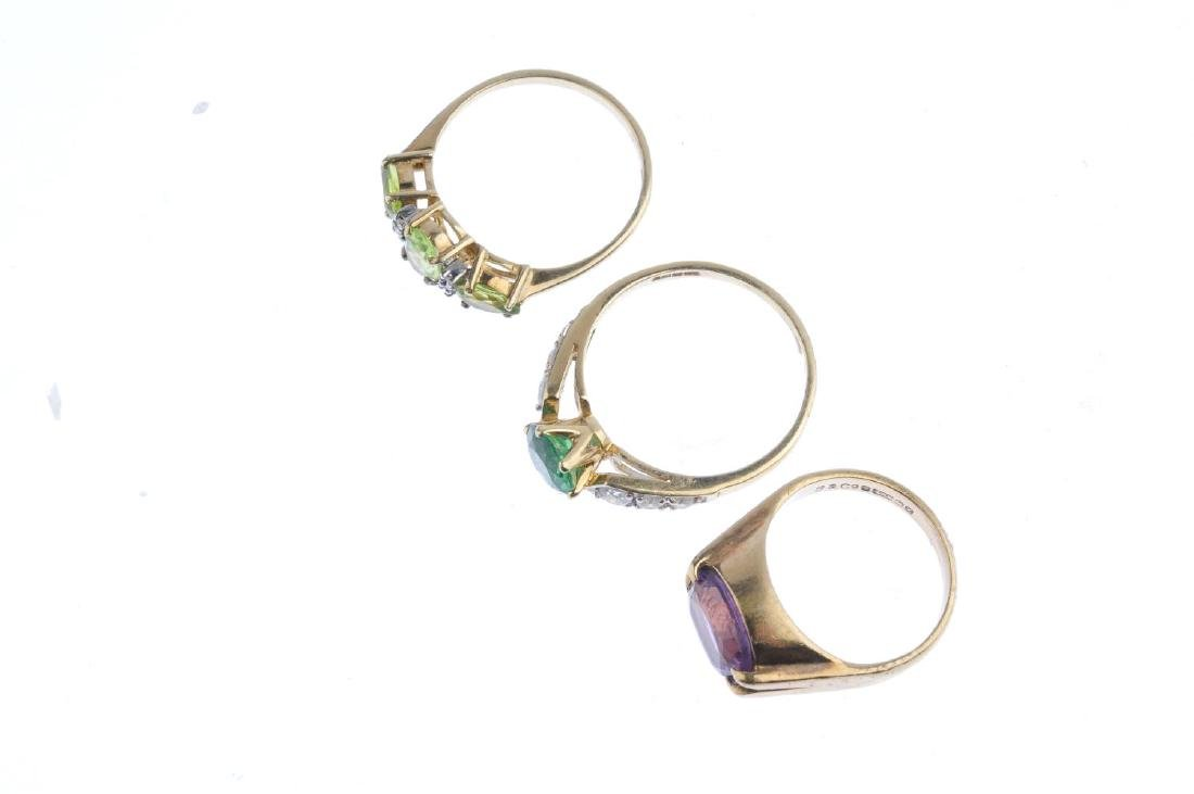 Three gold gem-set rings. To include a 9ct gold peridot - 2