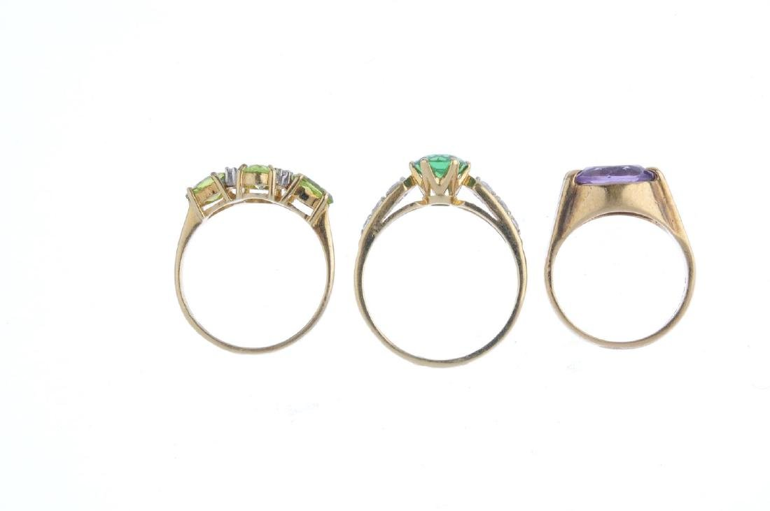 Three gold gem-set rings. To include a 9ct gold peridot - 3