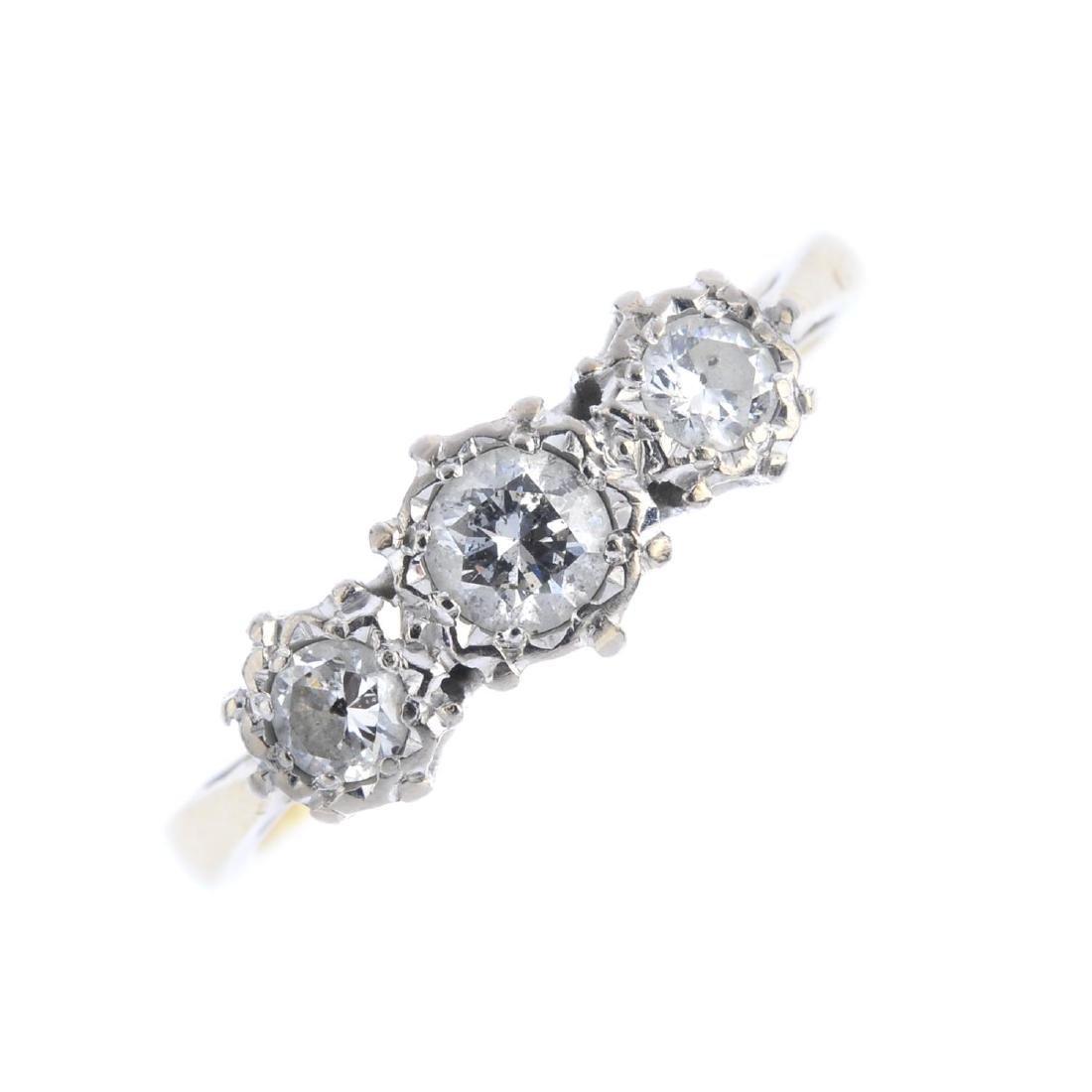 A diamond three-stone ring. Three graduated