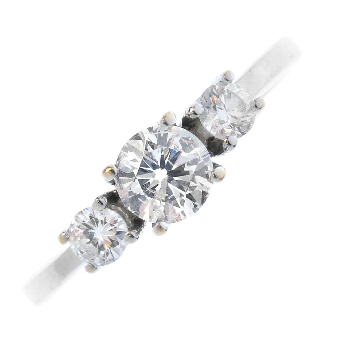 A fracture-filled diamond three-stone ring. The