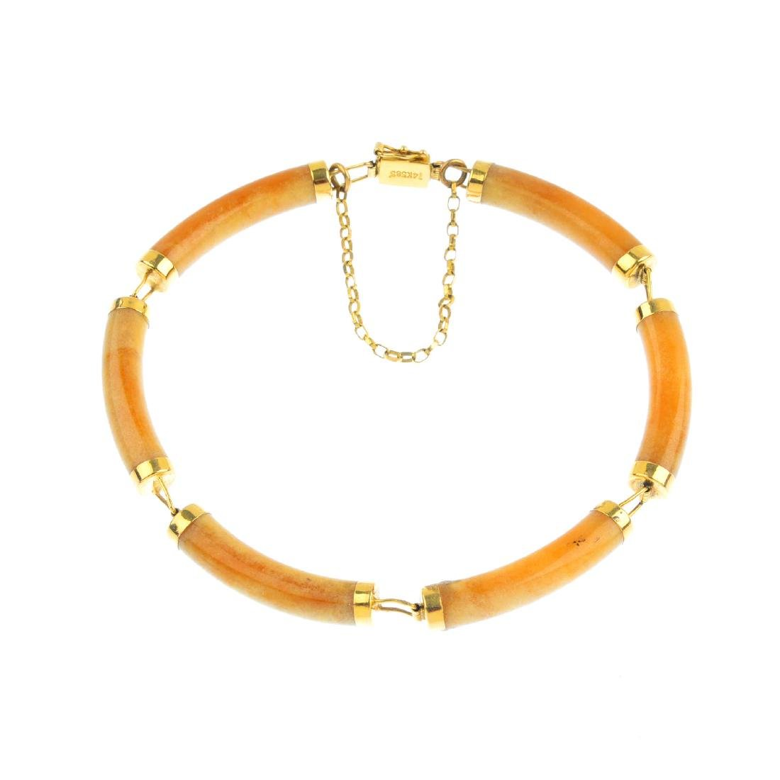 An agate bracelet. Designed as a series of agate curved