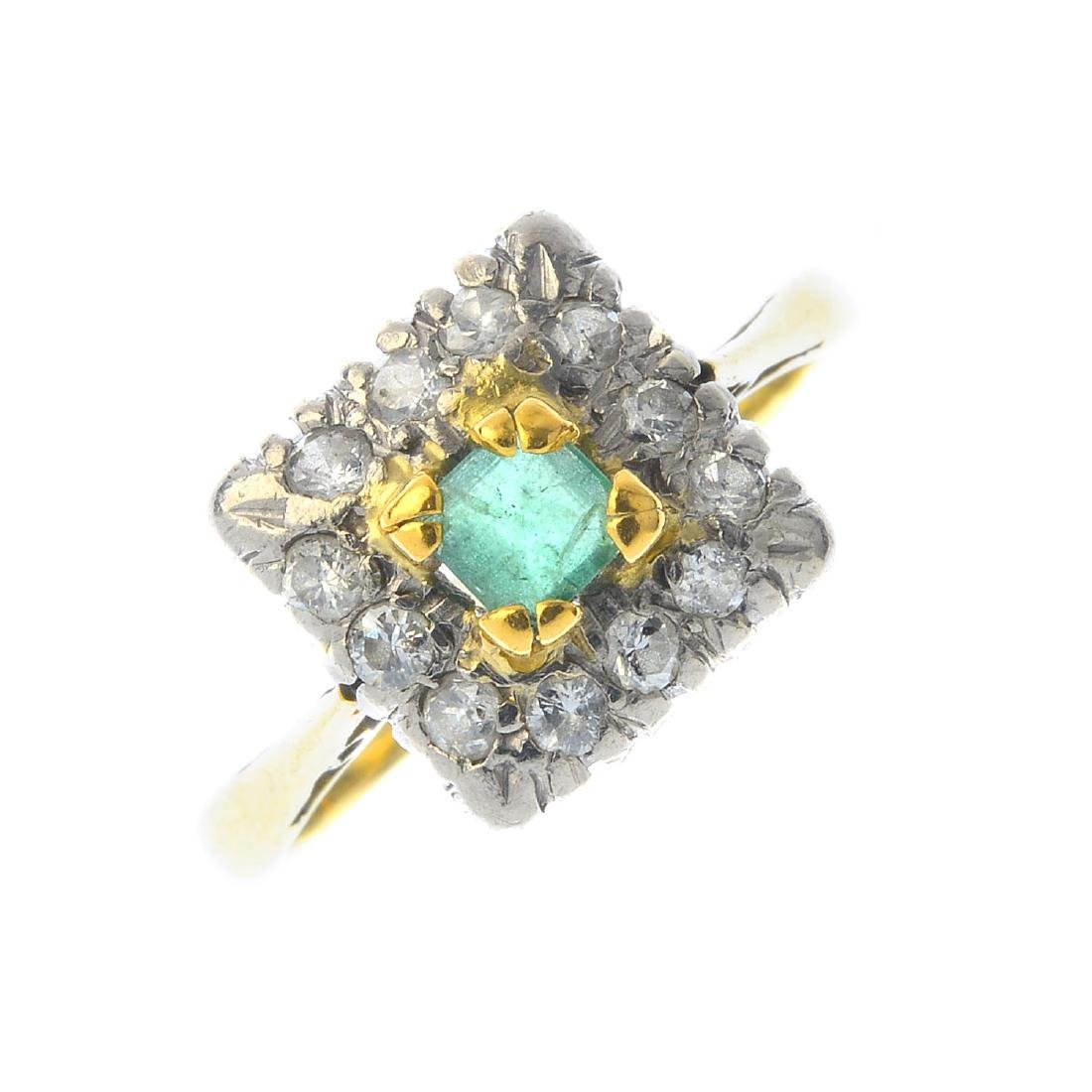 An emerald and diamond cluster ring. Of square outline,