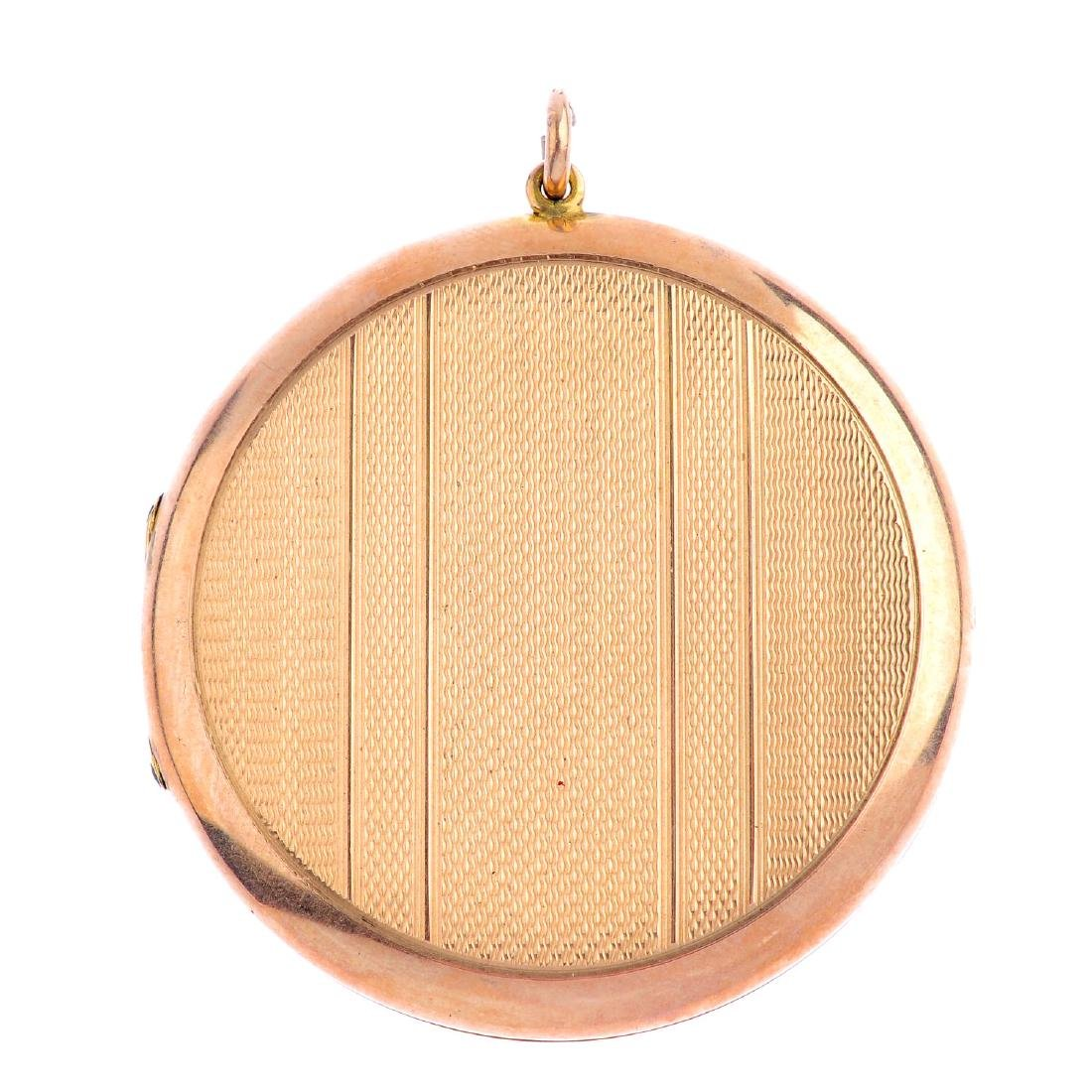 A 1930s 9ct gold locket pendant. Of circular outline,