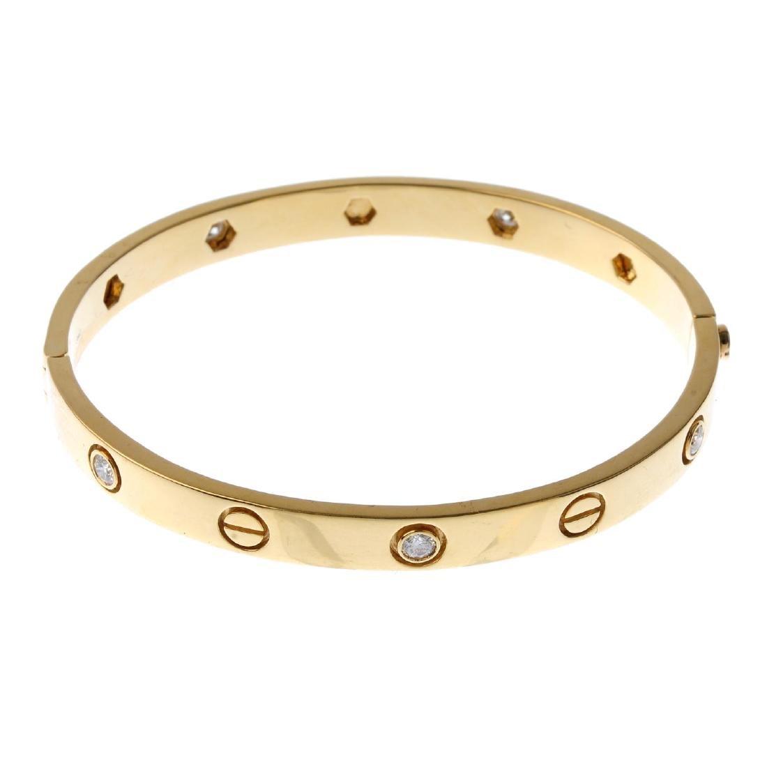 A diamond hinged bangle. Designed as an alternating