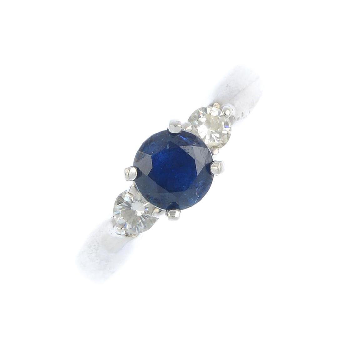 A sapphire and diamond three-stone ring. The
