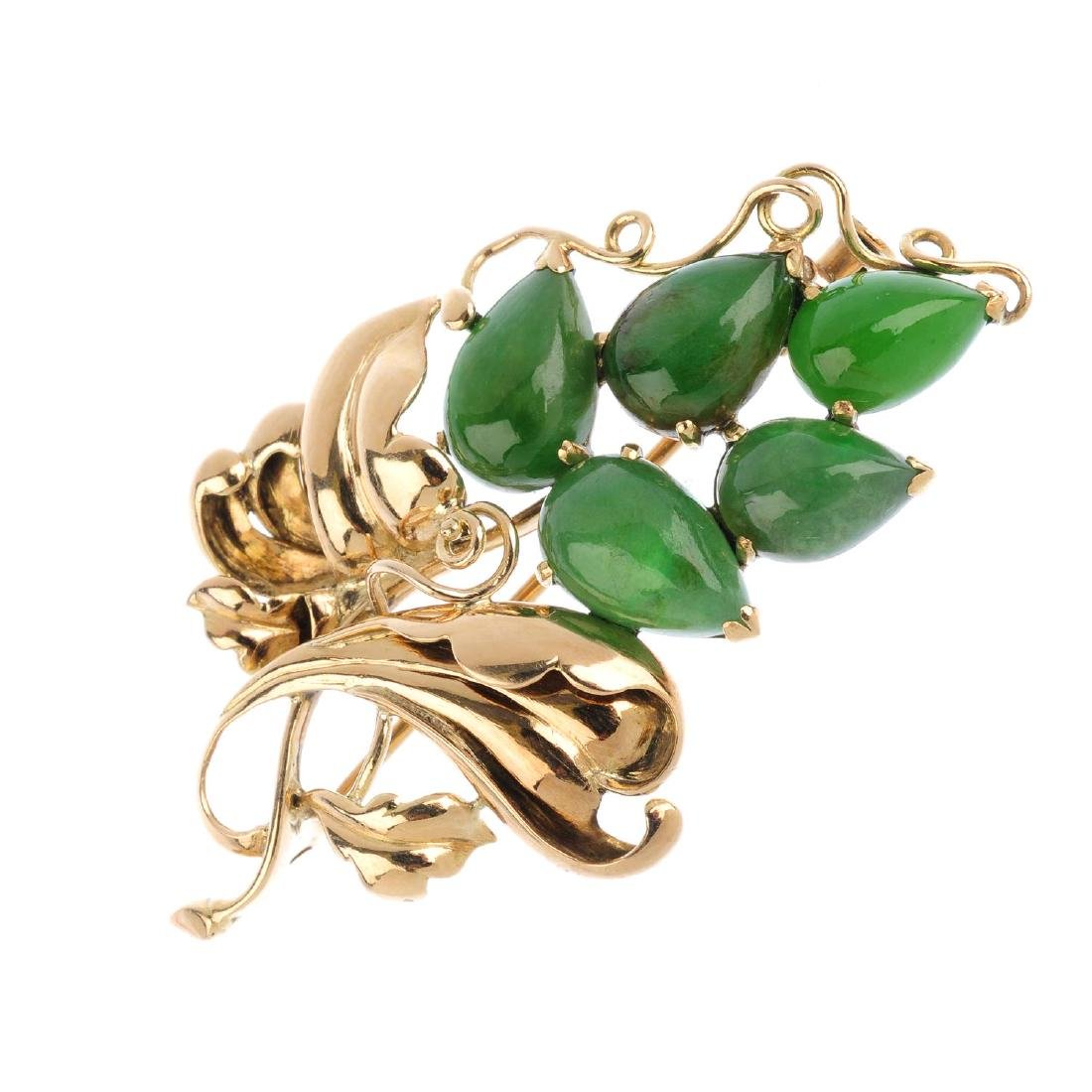 A jade brooch. Of floral design, the graduated