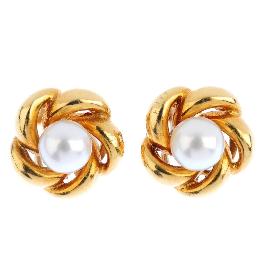 A pair of 18ct gold cultured pearl earrings. Each