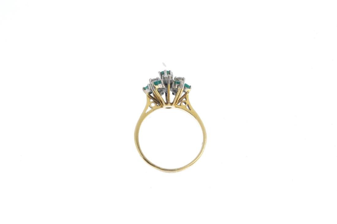 An 18ct gold emerald and diamond cluster ring. The - 2