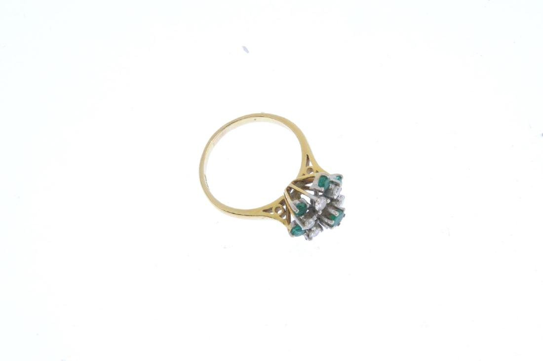 An 18ct gold emerald and diamond cluster ring. The - 3