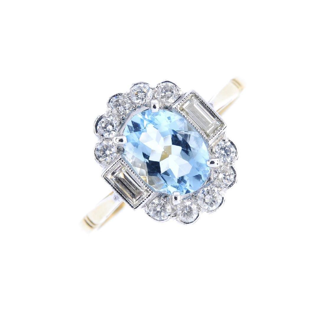 An aquamarine and diamond dress ring. The oval-shape