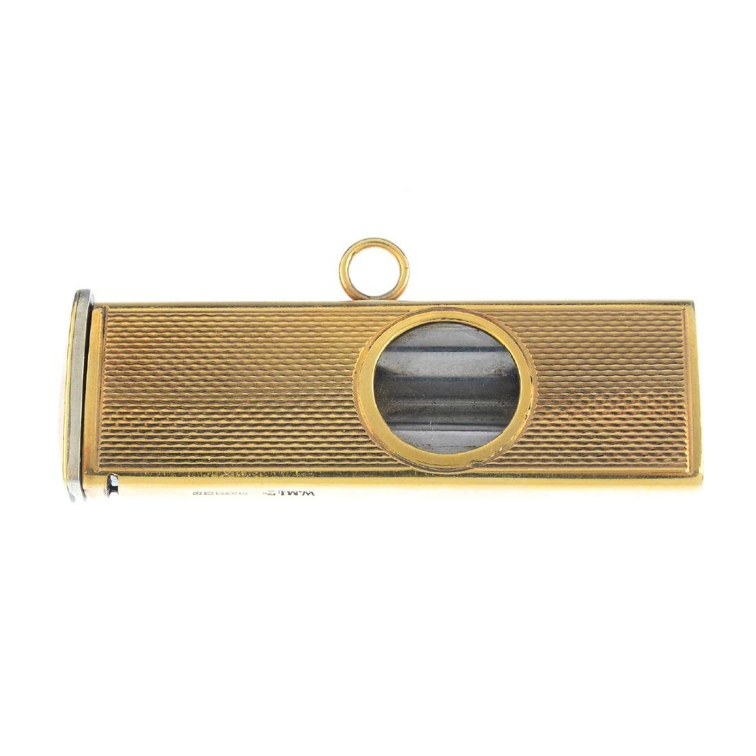 A mid 20th century 9ct gold cigar cutter. Of