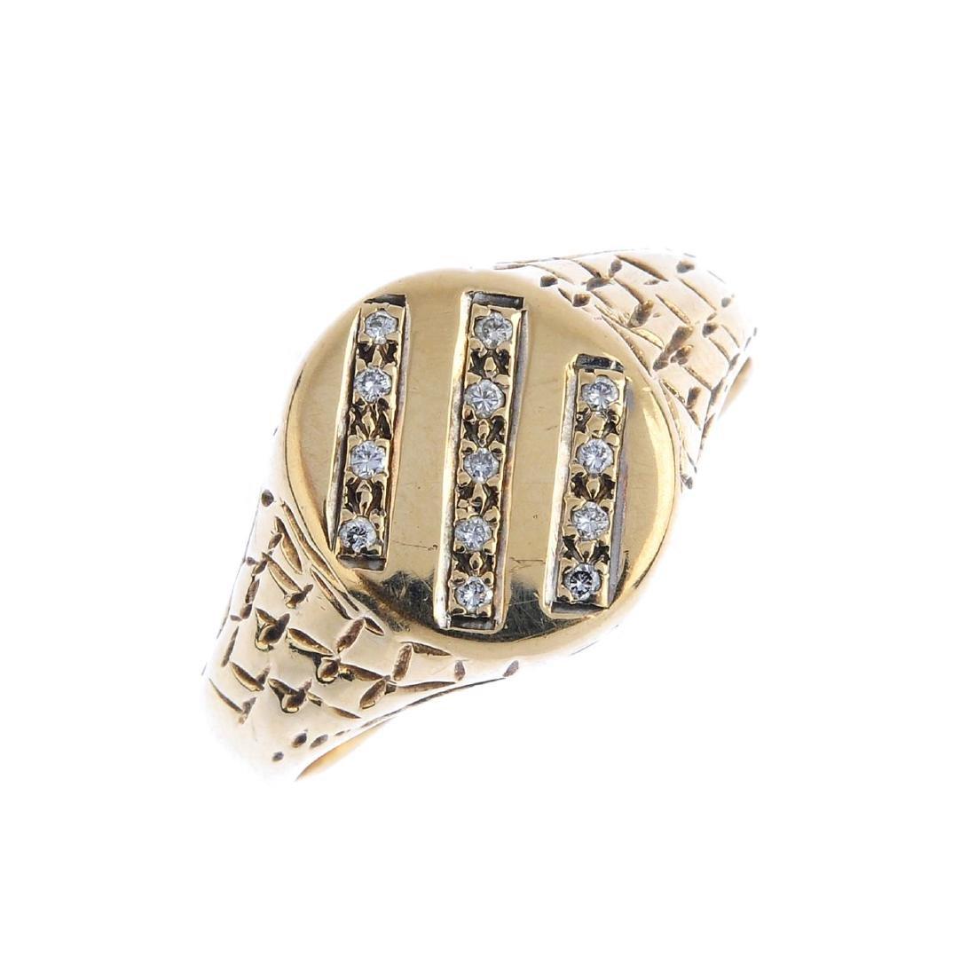 A gentleman's 9ct gold diamond signet ring. The