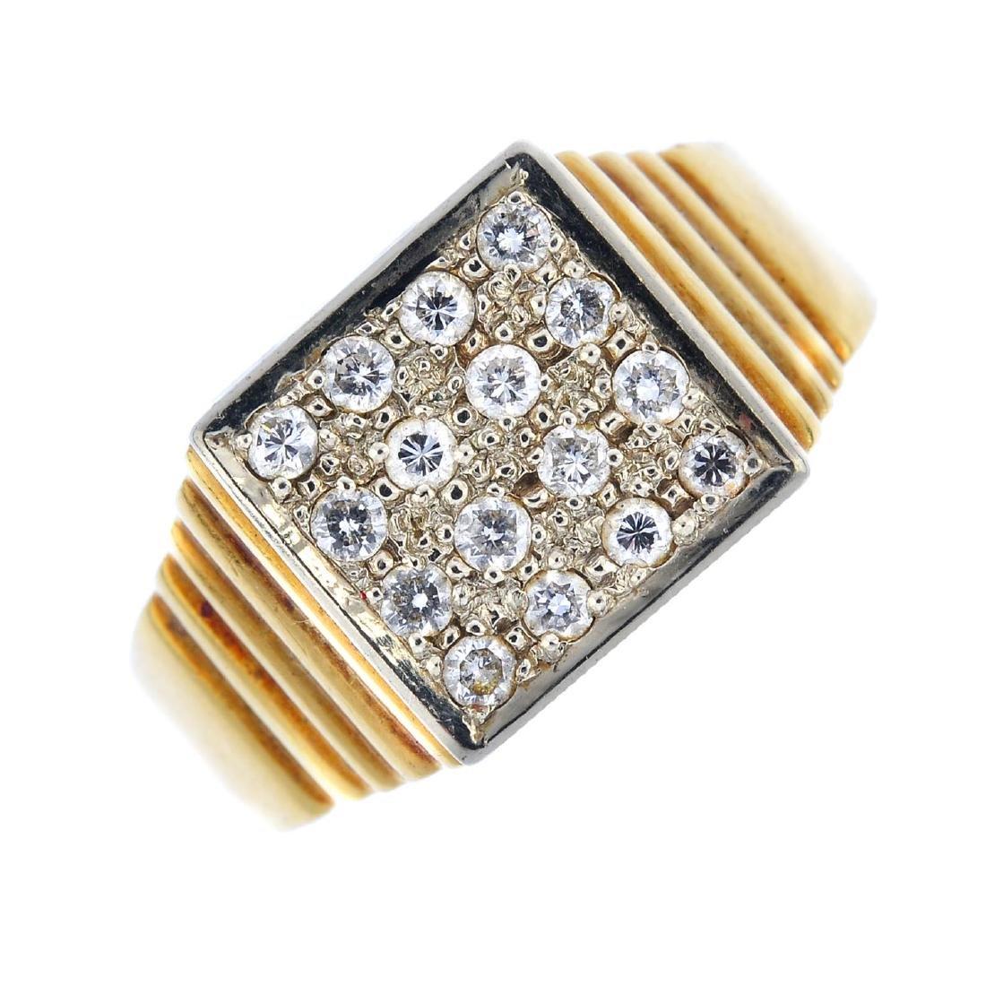 A gentleman's diamond signet ring. The pave-set diamond