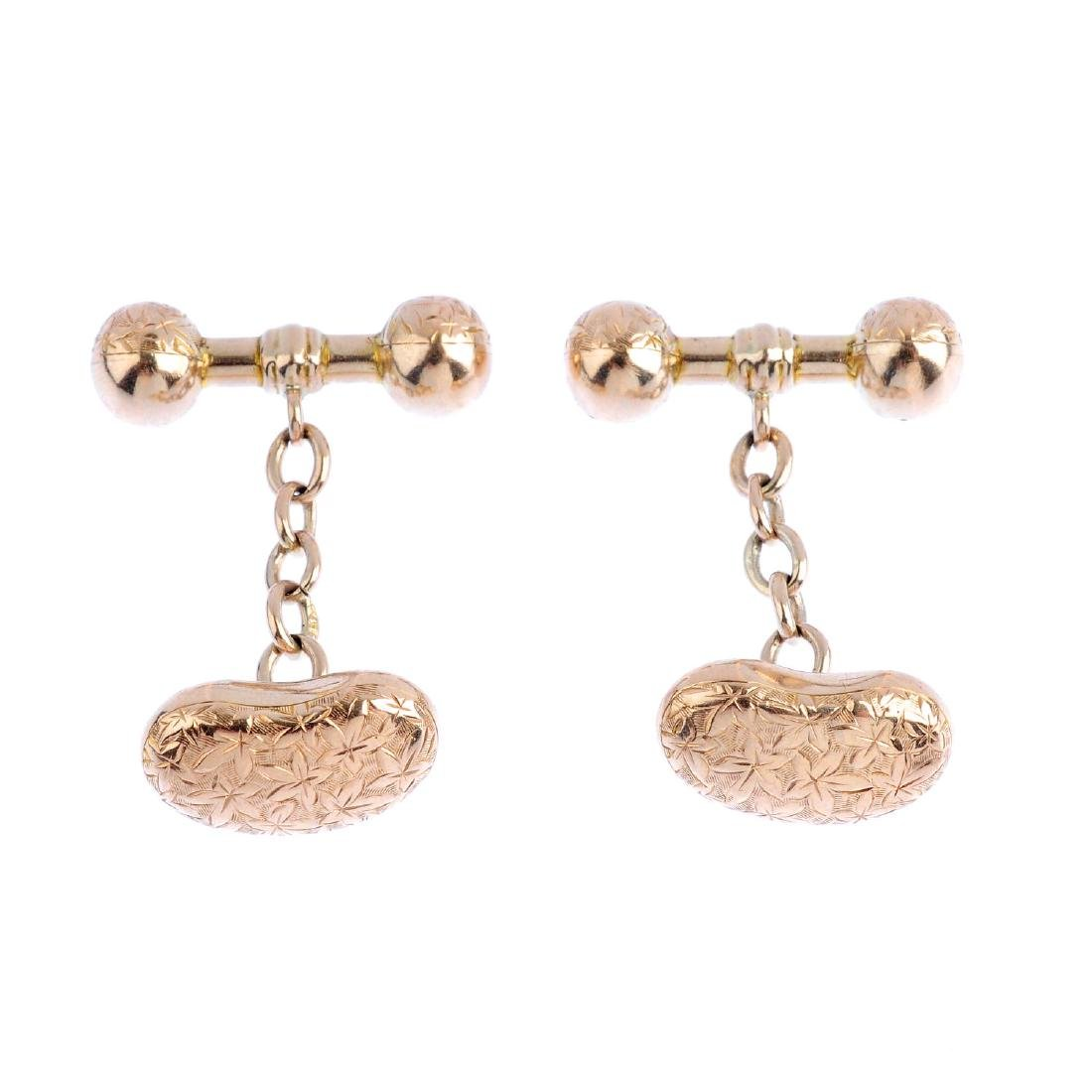 A pair of early 20th century 9ct gold cufflinks. Each