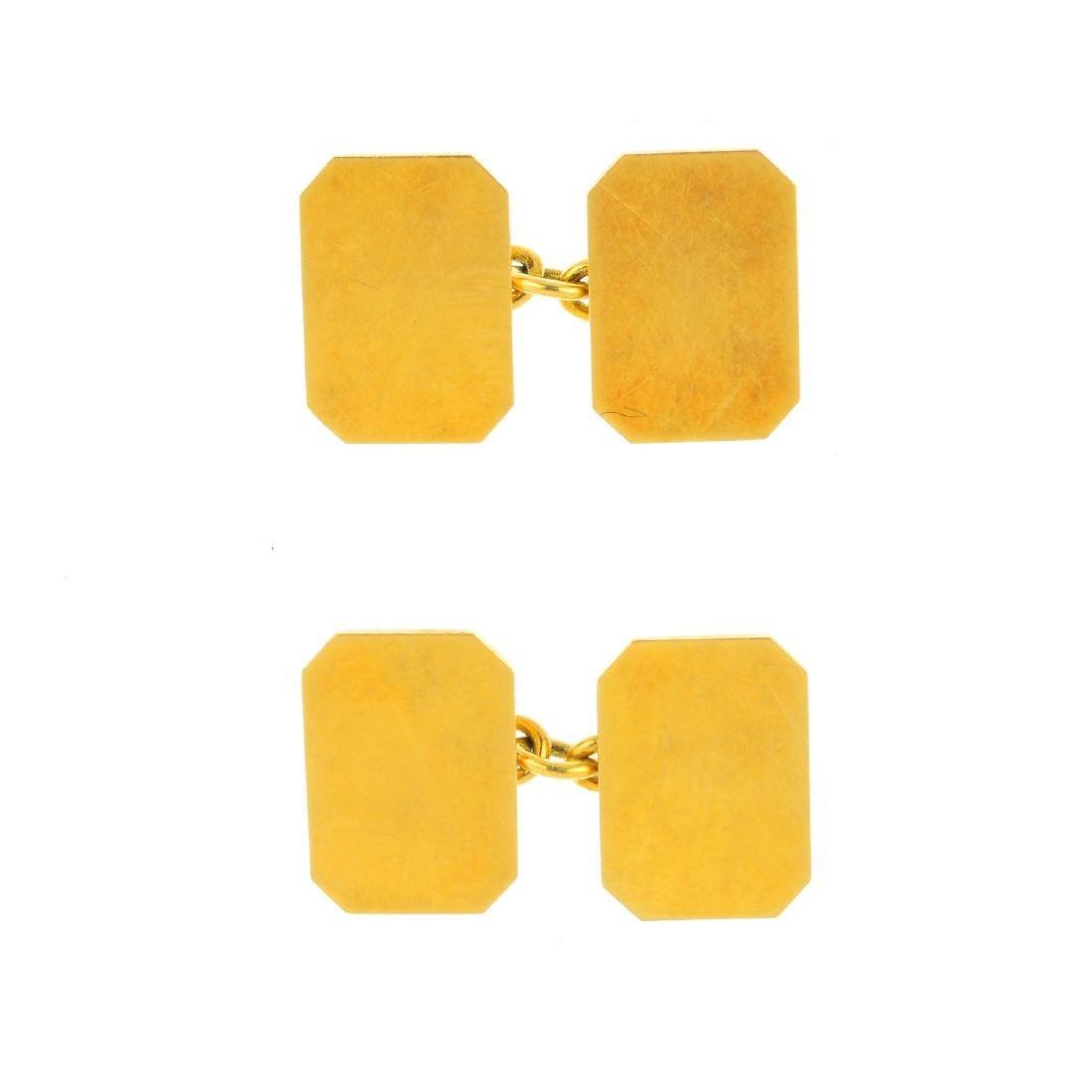 A pair of 1960s 18ct gold cufflinks. Each deigned as