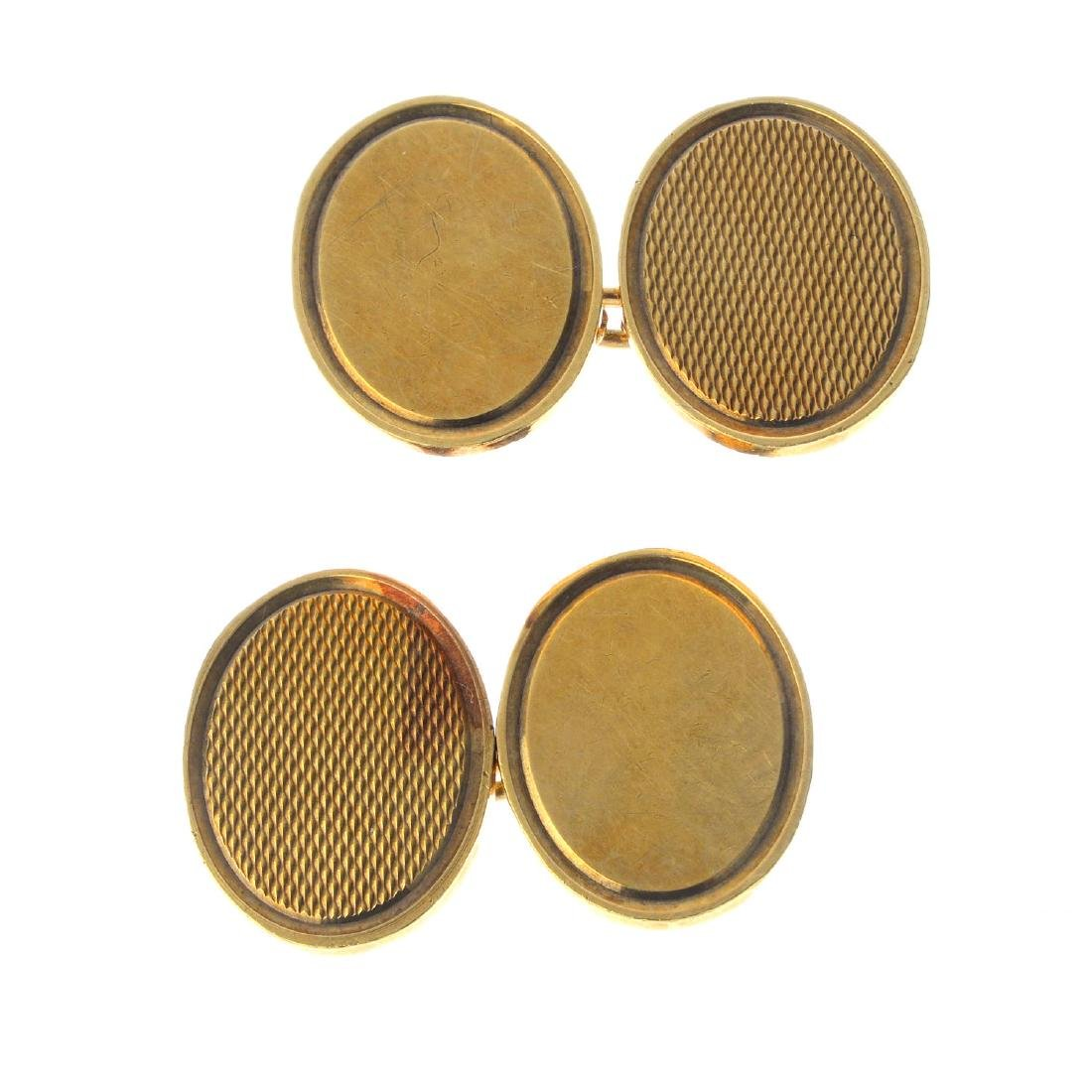 A pair of 1970s 9ct gold cufflinks. Each designed as