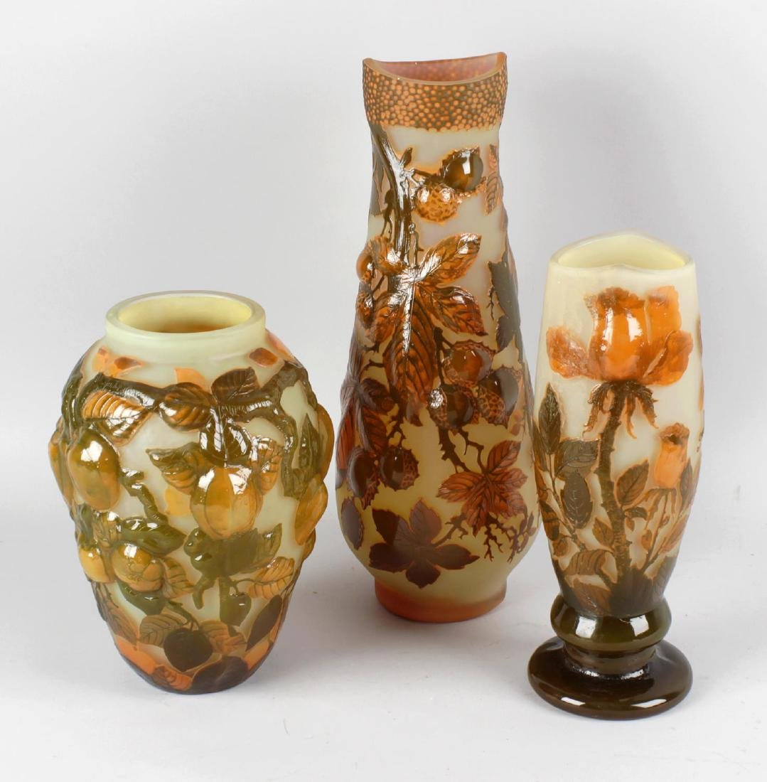 A reproduction Galle cameo style glass vase decorated