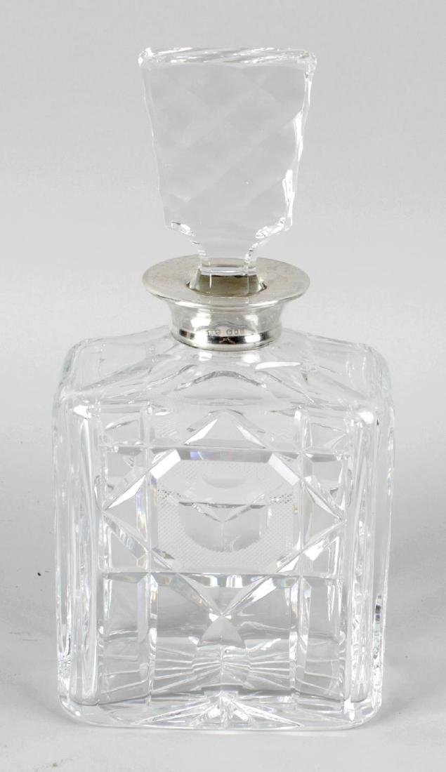 A cut glass decanter and stopper, of rectangular form