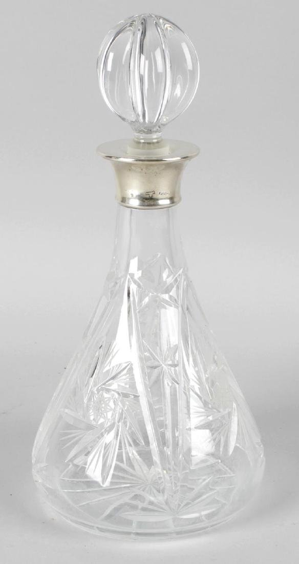 A cut glass decanter and stopper, of mallet shaped form