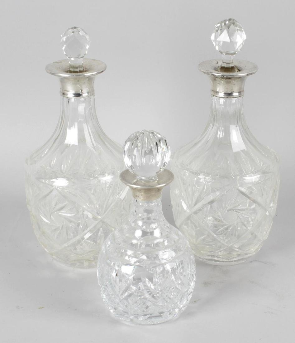 A pair of cut glass decanters, each with applied London