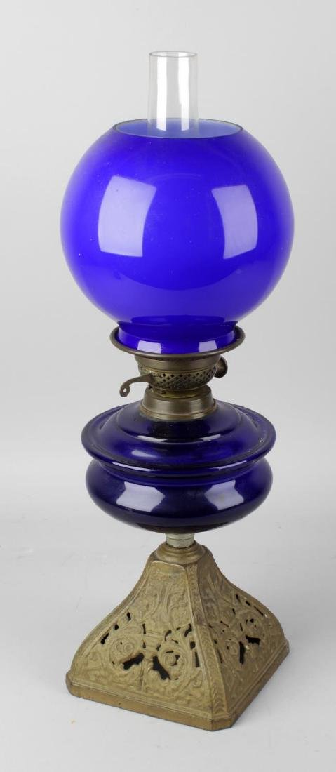 A late 19th century oil lamp, the Bristol blue glass