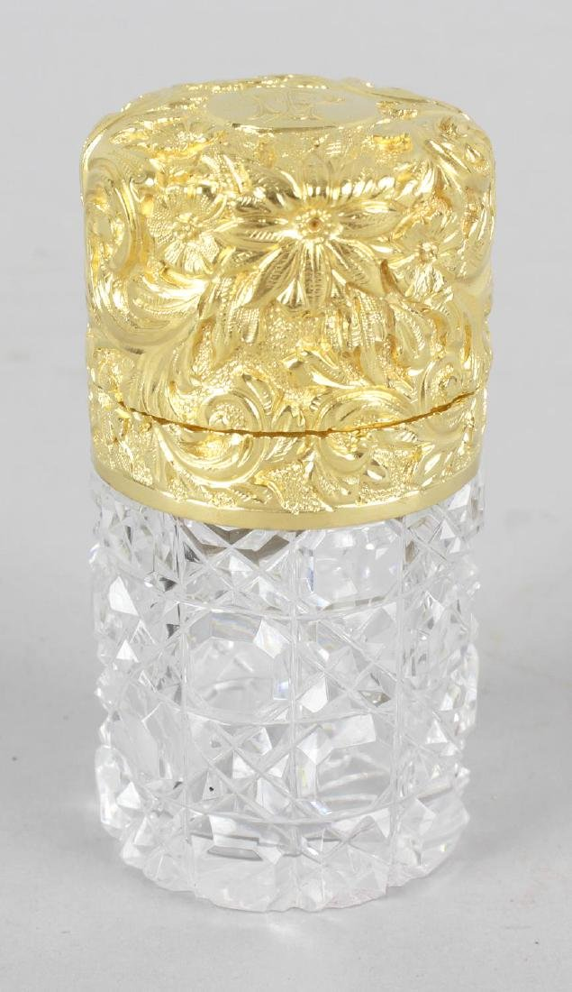 A Victorian hallmarked silver gilt topped scent bottle,