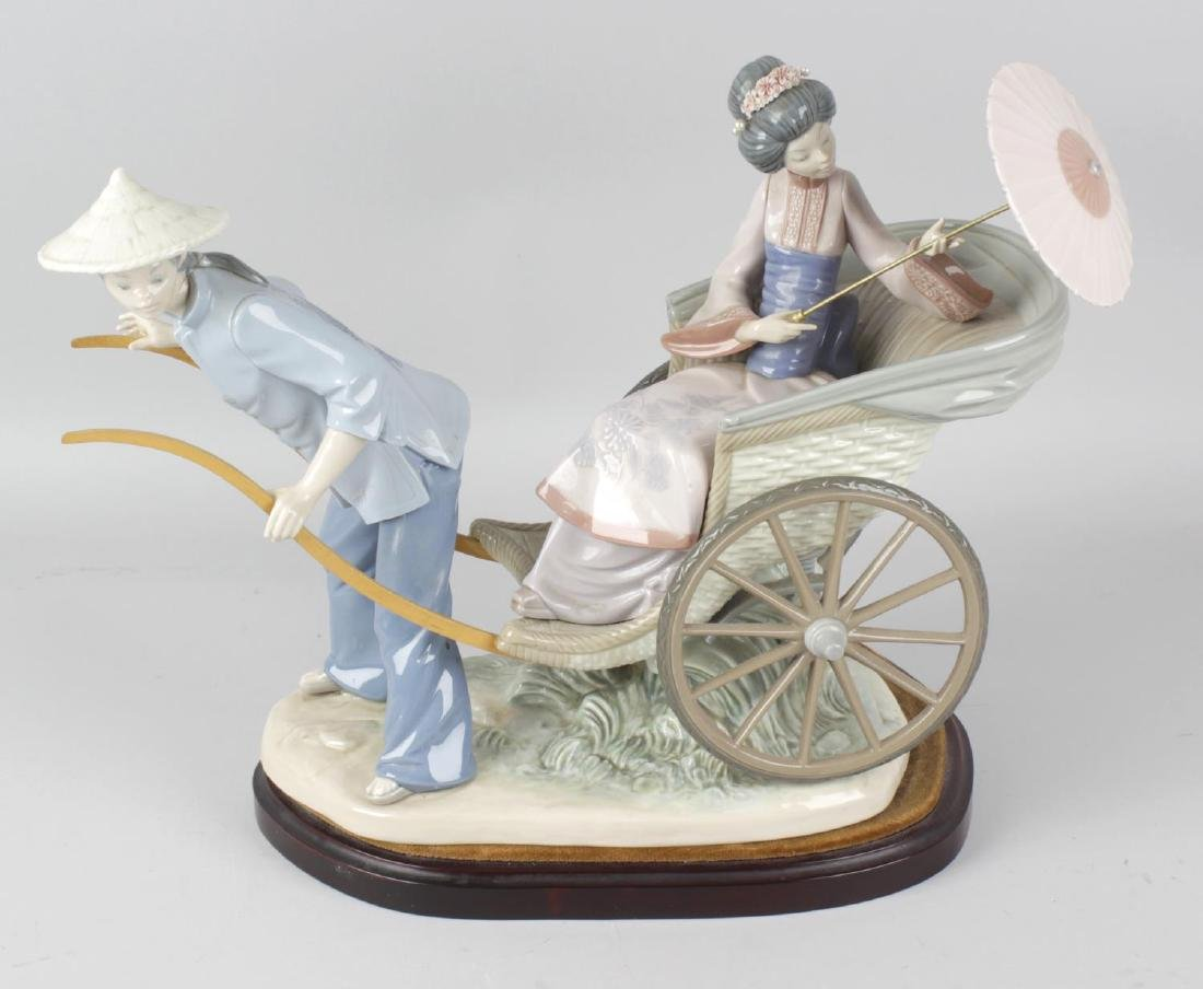 A large Lladro figure group, 'Ride in China', modelled