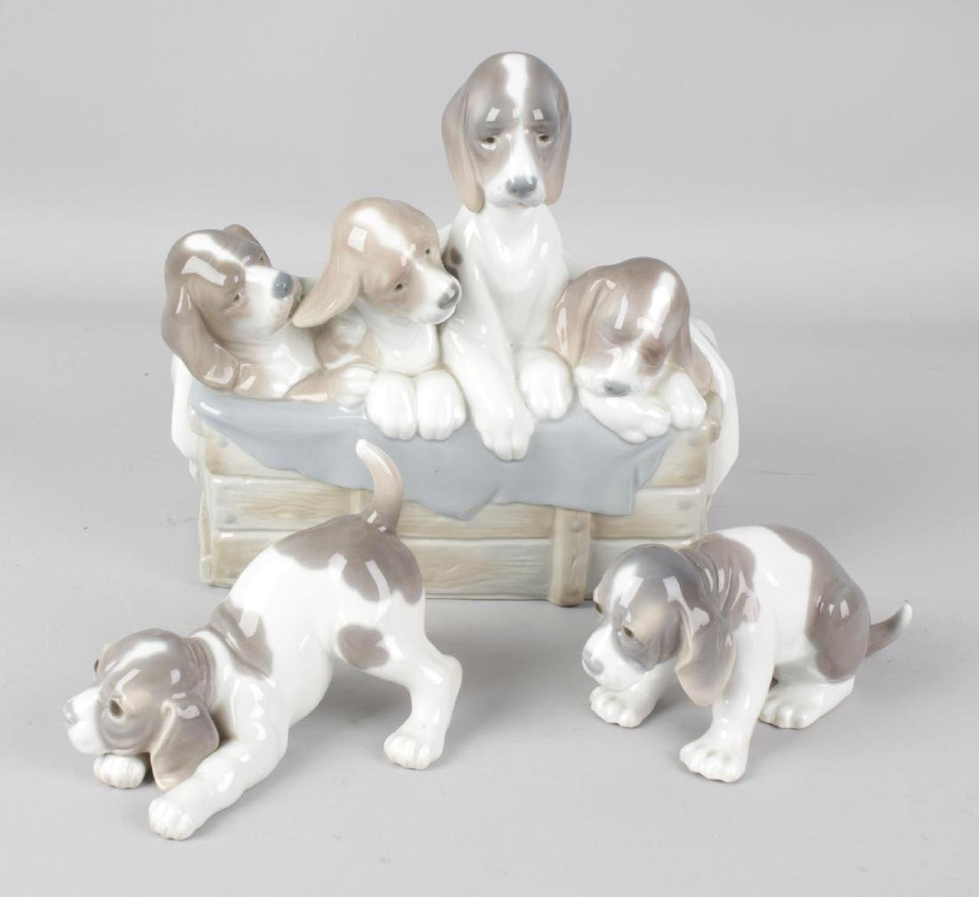 Three Lladro figurines modelled as dogs, the largest