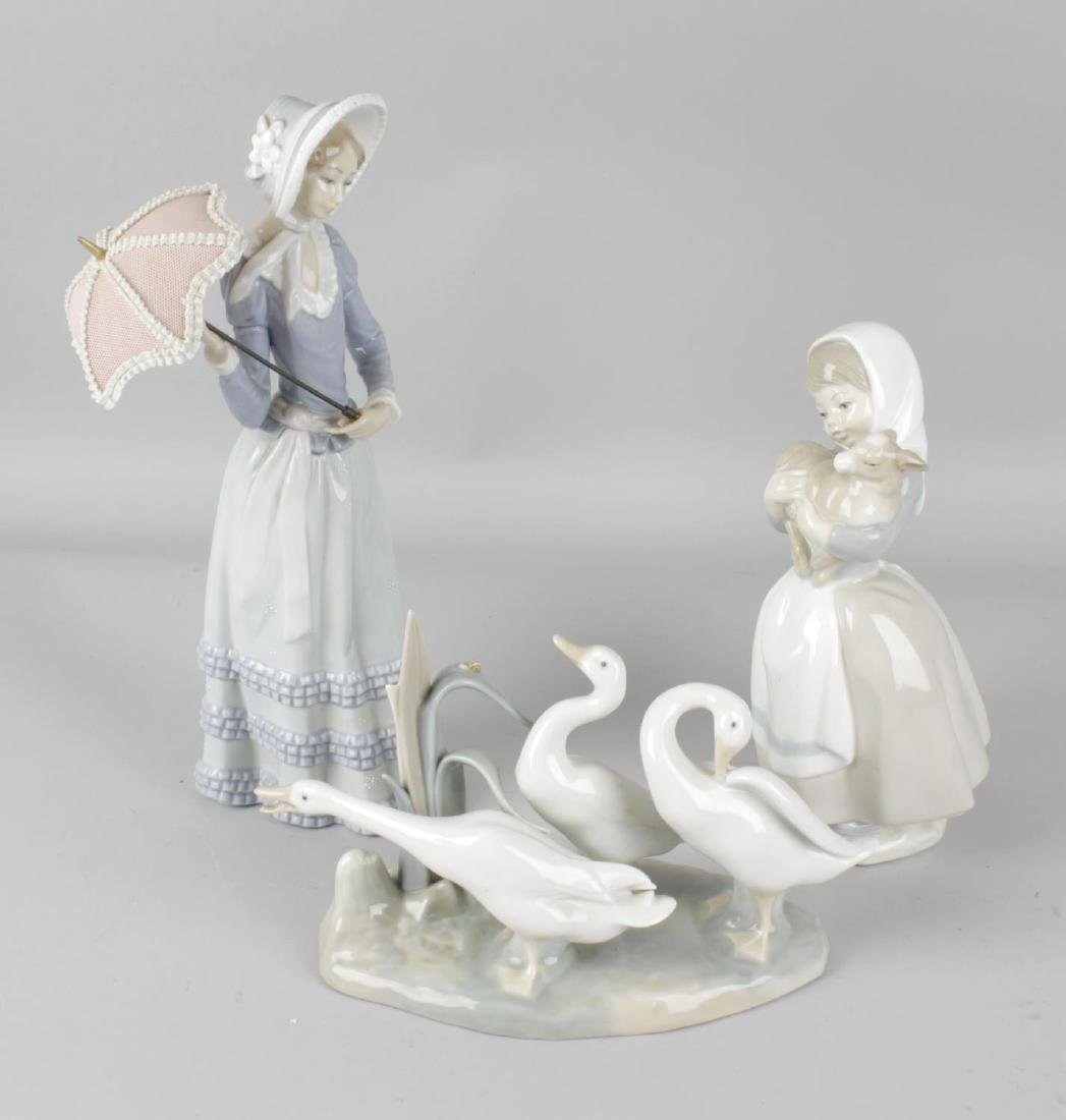 A Lladro figurine modelled as a woman in bonnet with
